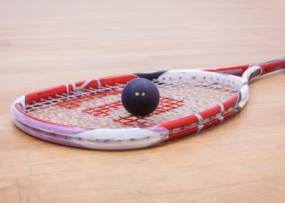squash ball on squash rackets on the court